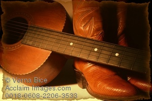 picture of cowboy boots and guitar photo